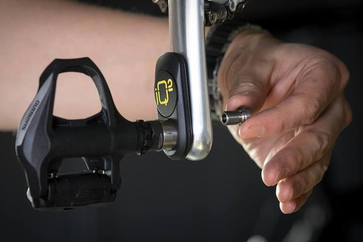 The IQ² is installed between the pedal and the crank