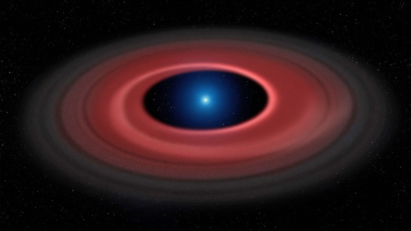 The disk of material surrounding the white dwarf SDSS J1228+1040, as pictured here in an artist's impression, is thought to be the remnants of an asteroid