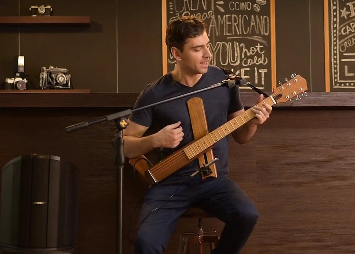 The folding Cross Guitar 2.0 has a built-in headphone amp that can be output to powered speakers