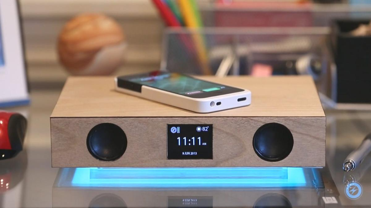 The Glowdeck Bluetooth speaker wirelessly charges a smartphone