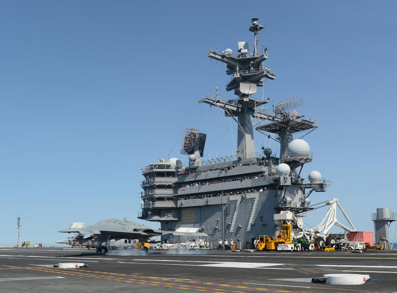 X-47B briefly touching the flight deck (Image: US Navy by Mass Communication Specialist 2nd Class Timothy Walter)