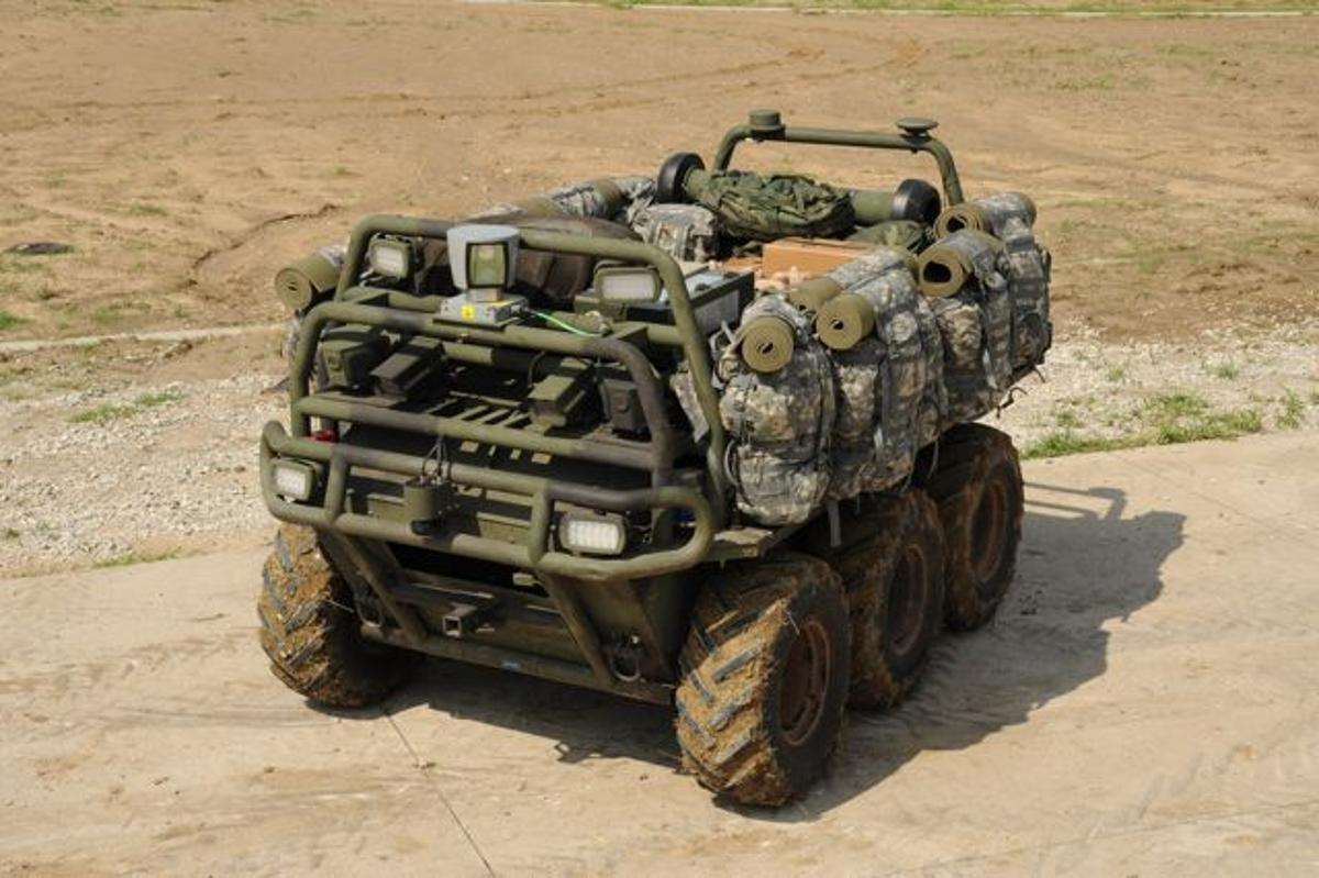 Lockheed Martin's autonomous Squad Mission Support System carries gear and charges batteries for troops