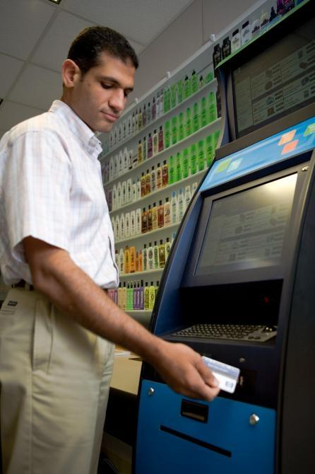 "With the swipe of a ""loyalty"" card at the experimental Retail Shopping Assistant, HP Labs researcher Mohamed Dekhil can extract a personal shopping list -- including special prices, just for him -- generated by the store, based on his previous purchases."