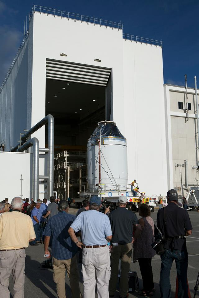 The Orion crew module and service module moves out of the Neil Armstrong Operations and Checkout Building at NASA's Kennedy Space Center (Image: NASA/Dan Casper)