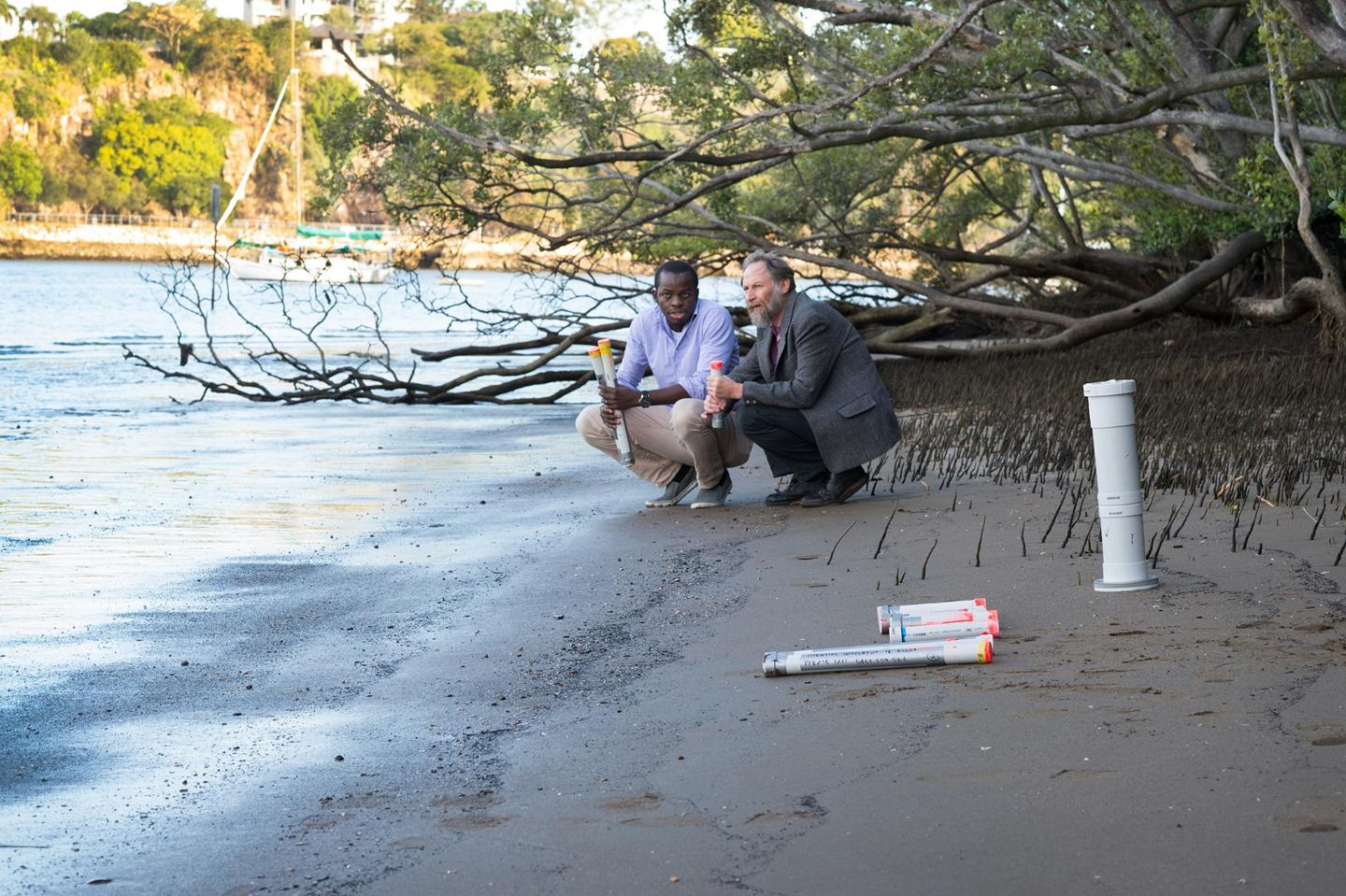 QUT researchers Dr Kabir Suara and Professor Richard Brown with their Drifter device