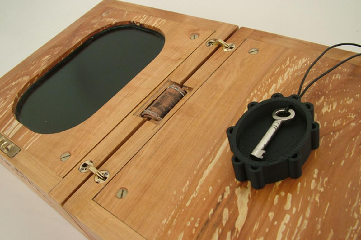 The Lovers Box opens like a book to display screen in portrait orientation