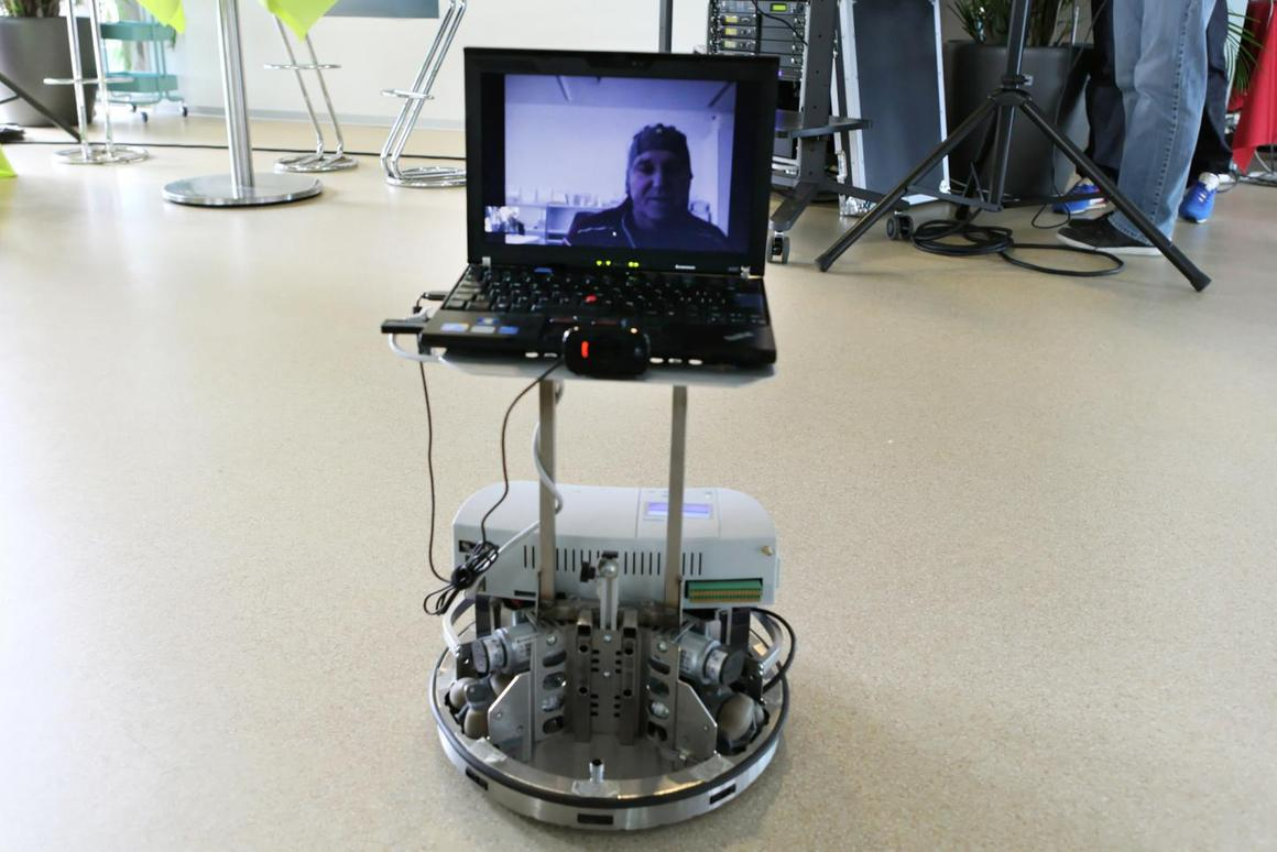 A man with severe motor disabilities controls a telepresence robot and interacts with people over Skype from his hospital bed