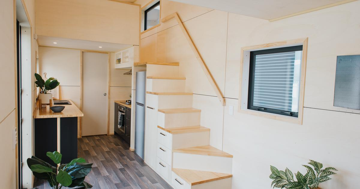 Turnkey tiny house squeezes in two storage-integrated staircases