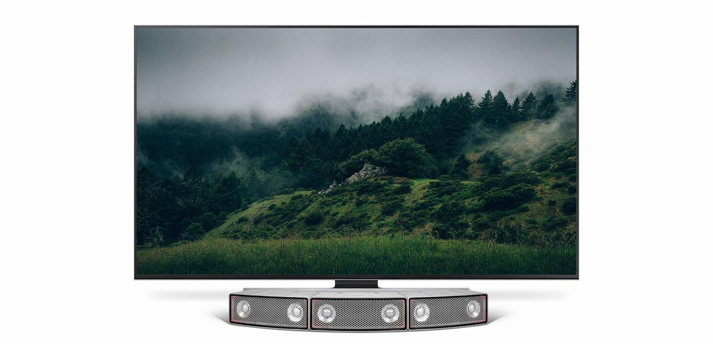 Three Soundots speakers working together to form a curved TV soundbar