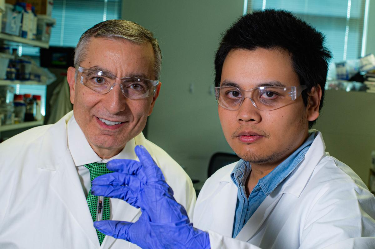 Rice University chemist James Tour, left, and graduate student Duy Luong with a sample of their flash graphene