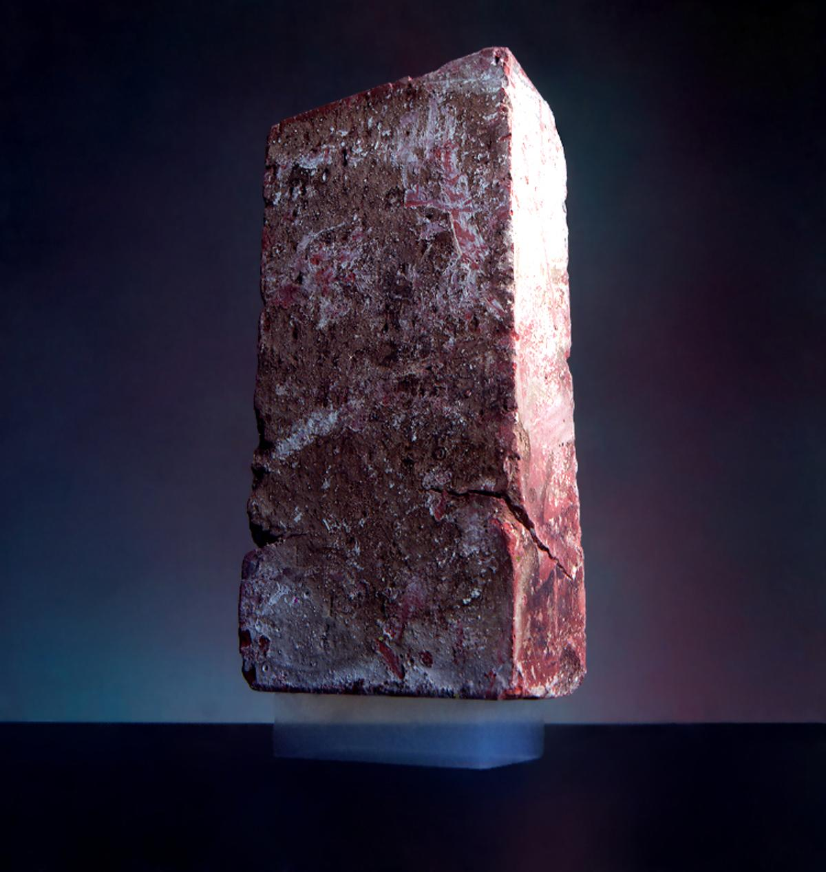 A 2.5 kg brick is supported by a piece of aerogel with a mass of only 2 grams