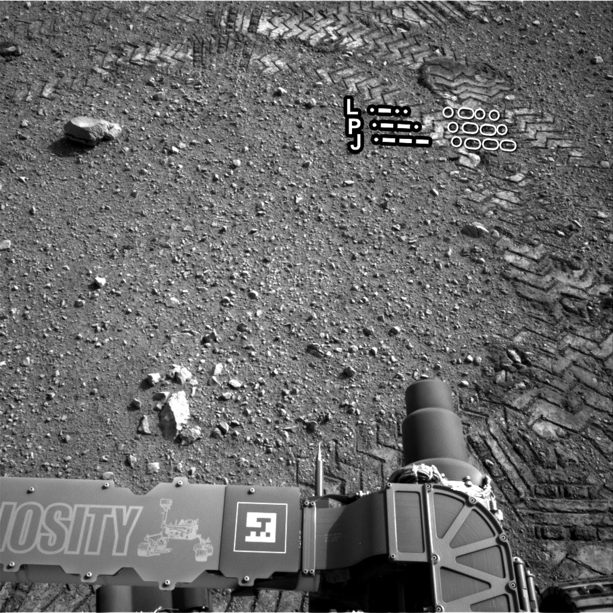 """Curiosity's track marks spelling out """"JPL"""" in Morse code (Image: NASA/JPL-Caltech)"""