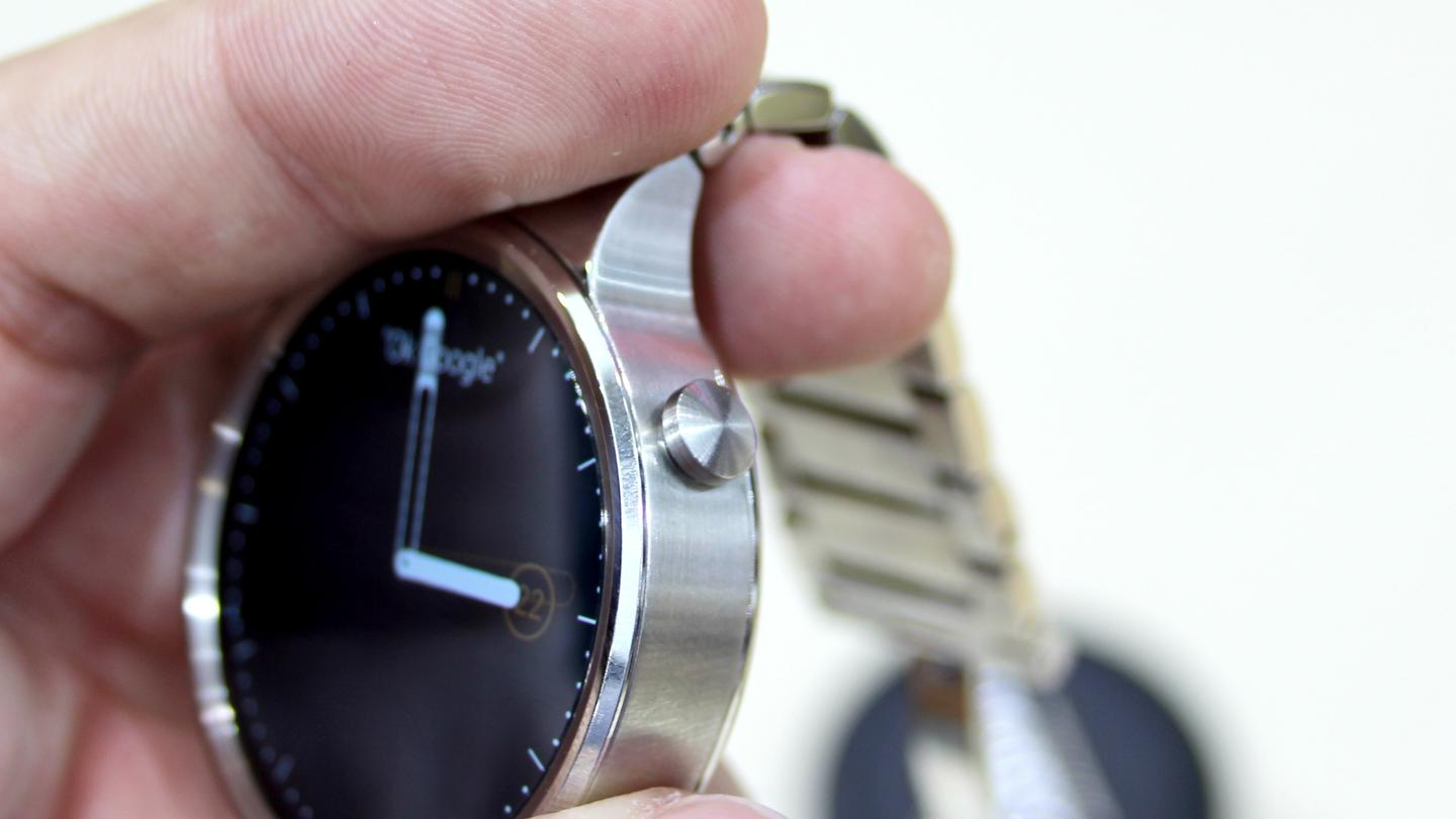 The watch has a crown button at the two o'clock position