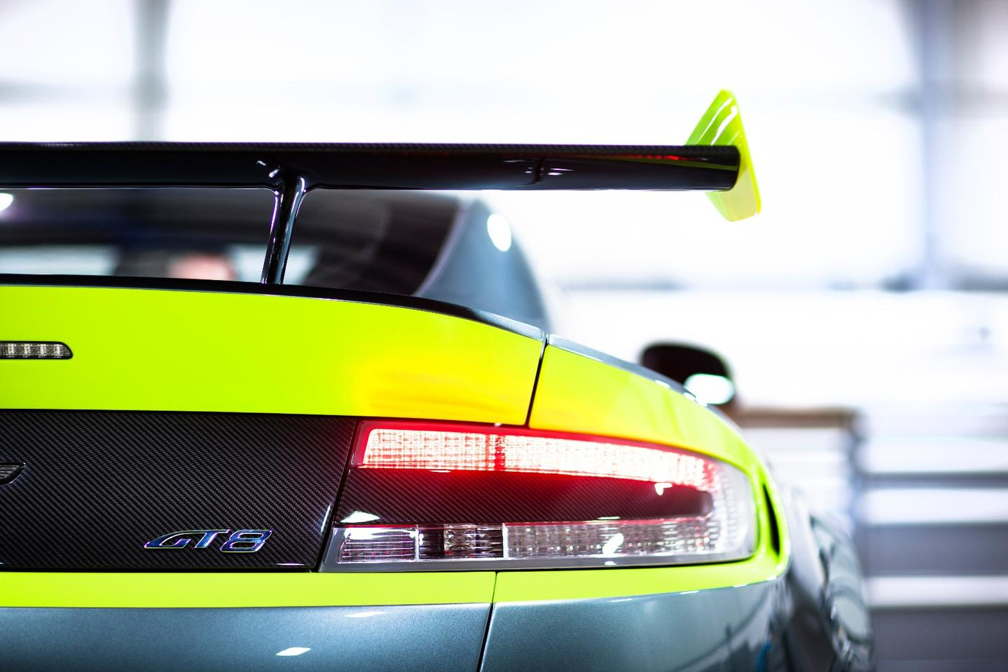 The yellow highlights are at odds with Aston Martin's usually restrained styling