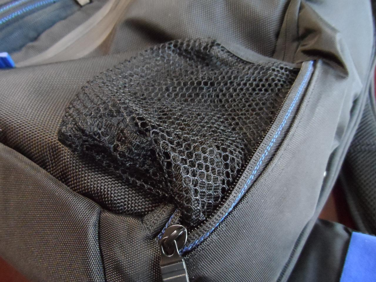 One of the front pouches features a pull-out drink holder
