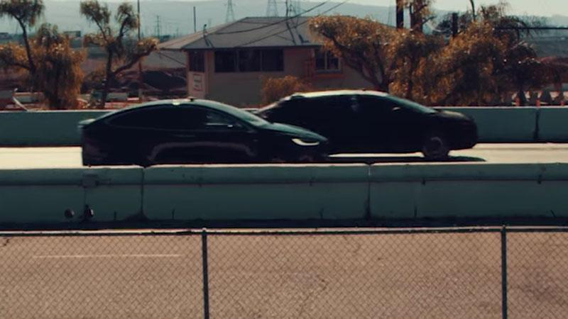 The Faraday Future streetcar prototype pulls away from a Tesla Model X P100D in Ludicrous mode