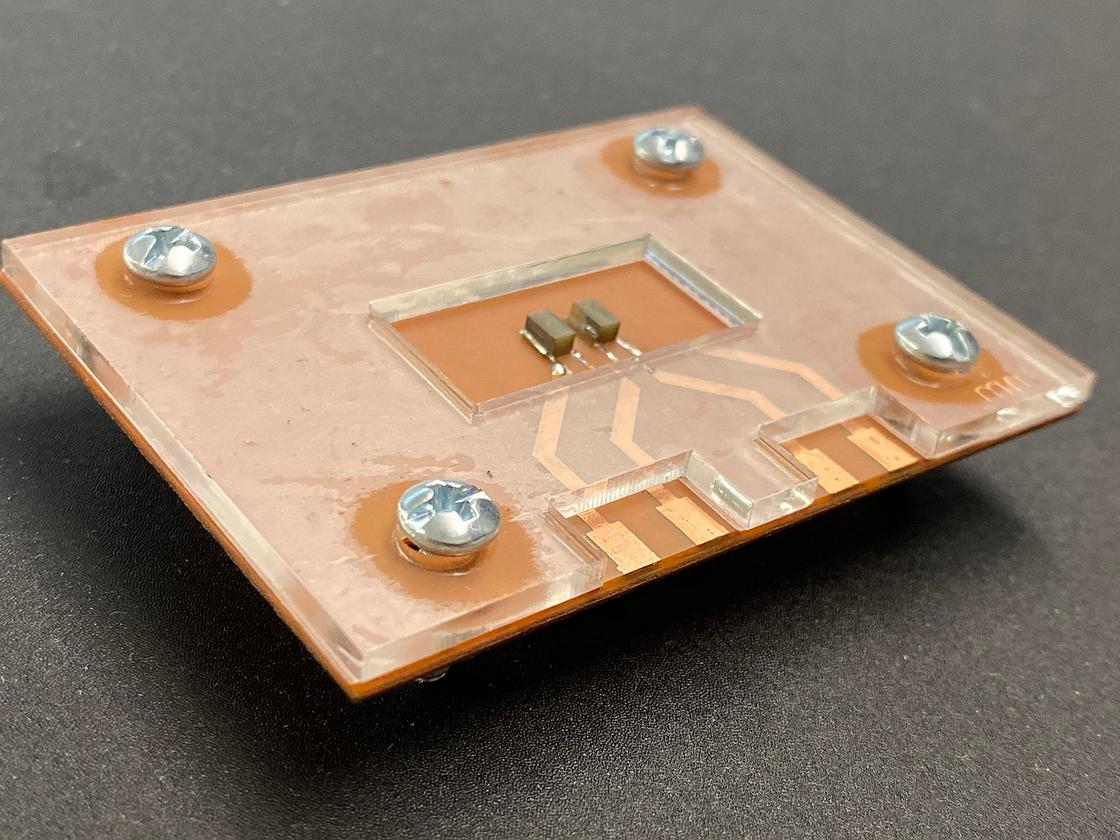 A lab-on-a-chip device developed at Purdue University uses sound waves to detect signs of disease