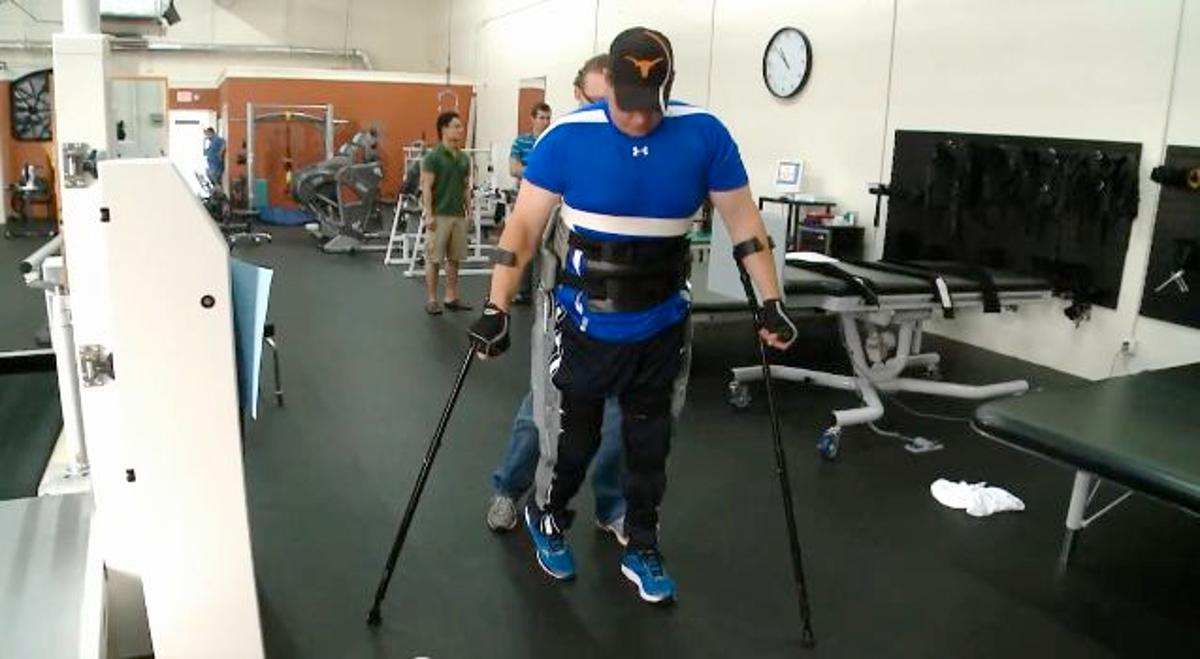 Test subject Brian Shaffer uses the prototype exoskeleton