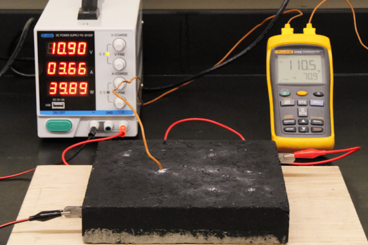Running a current through the conductive concrete warms it up