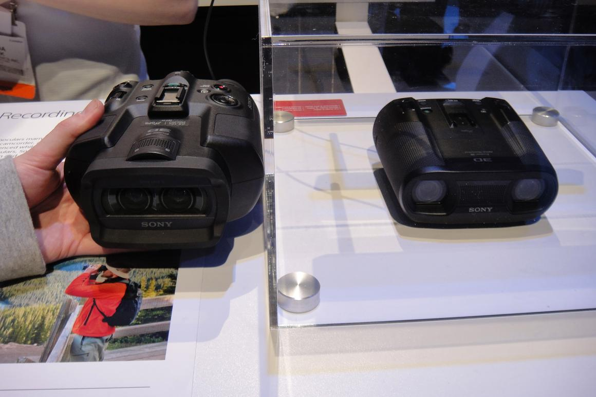 Sony's new prototype 3D digital recording binoculars (right) appear to be almost a third smaller than its predecessor seen on the left