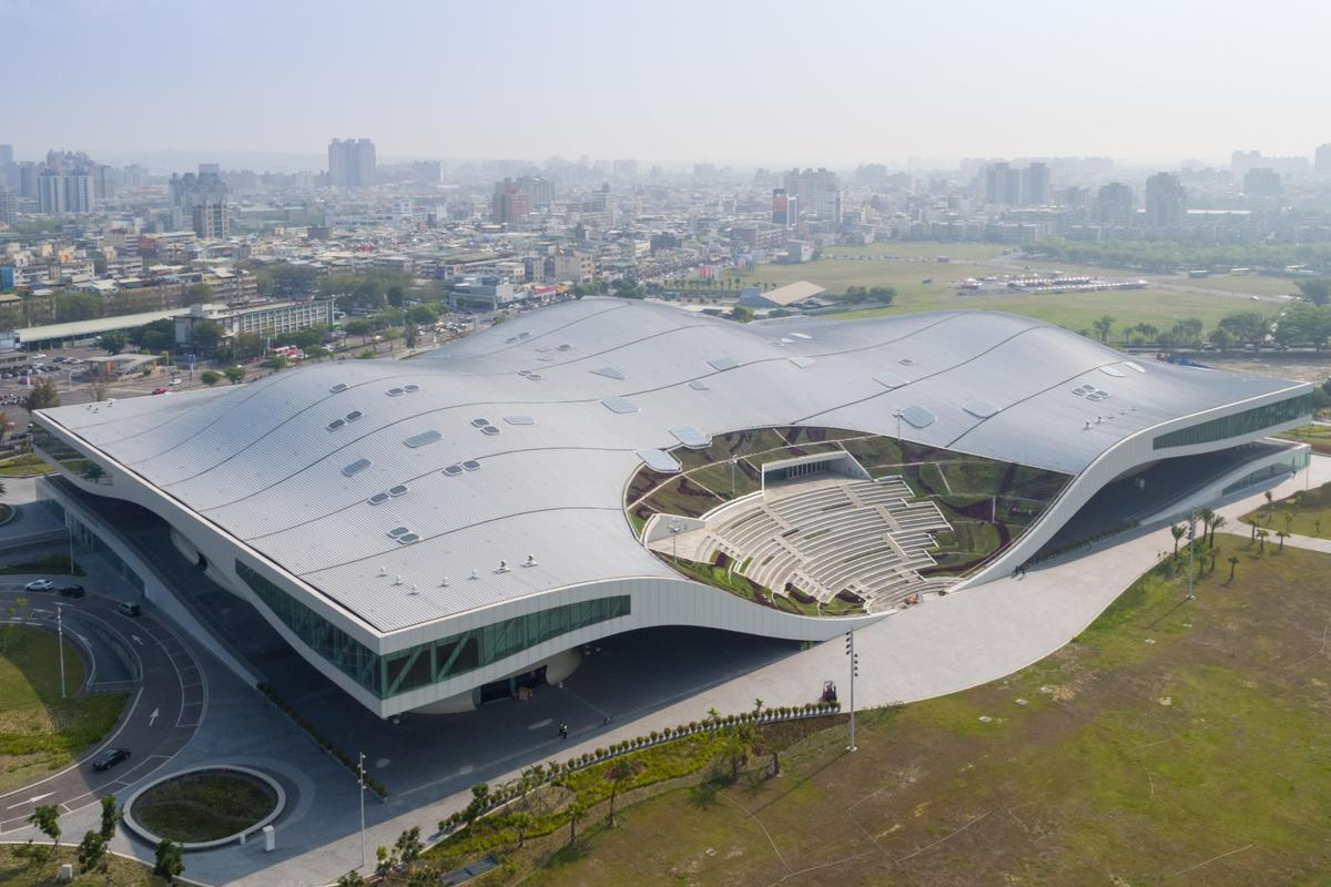 The National Kaohsiung Centre for the Arts in Taiwan houses a huge public plaza under its undulating roof