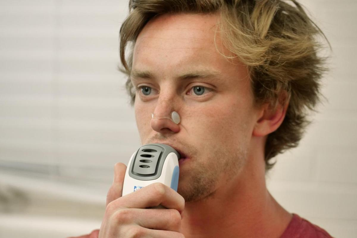 Study author Tom Heinbockel demonstrates an IMST device