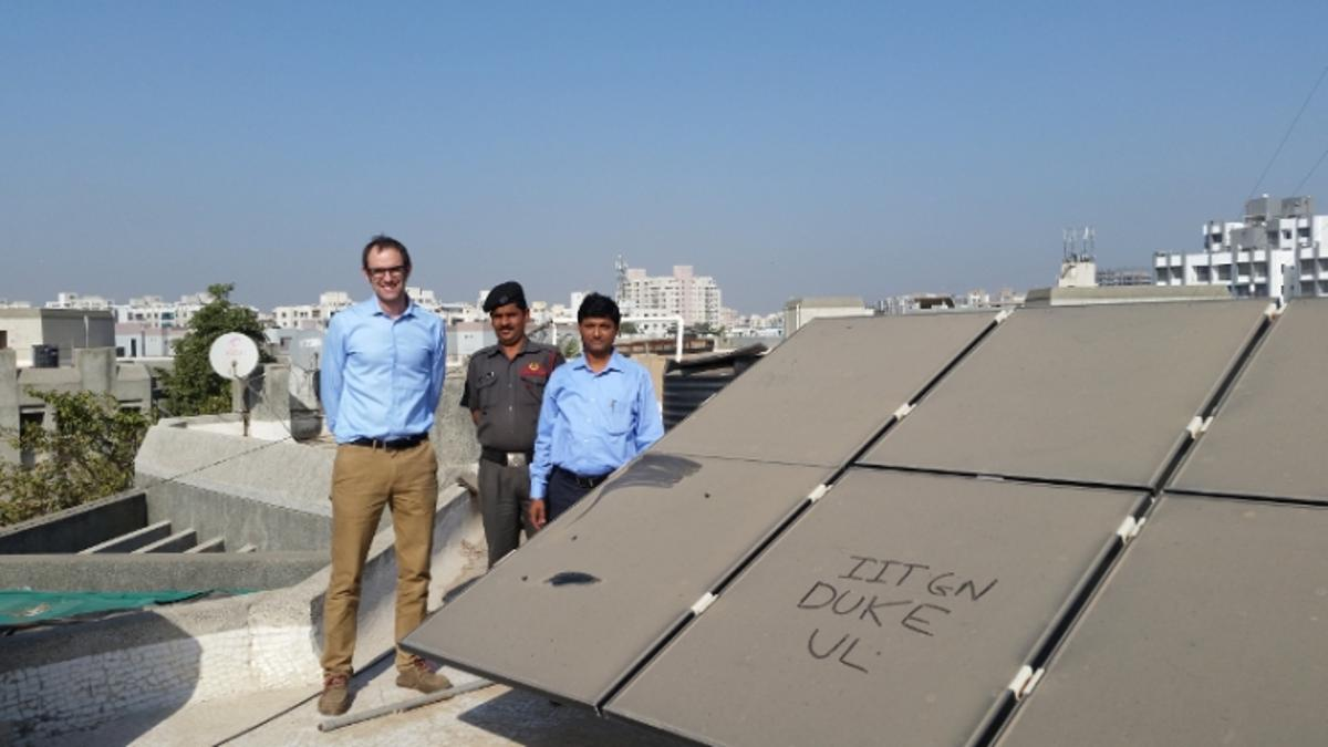Duke engineering professor Michael Bergin (left) stands with Indian Institute of Technology-Gandhinagar colleague Chinmay Ghoro next to a dusty solar array