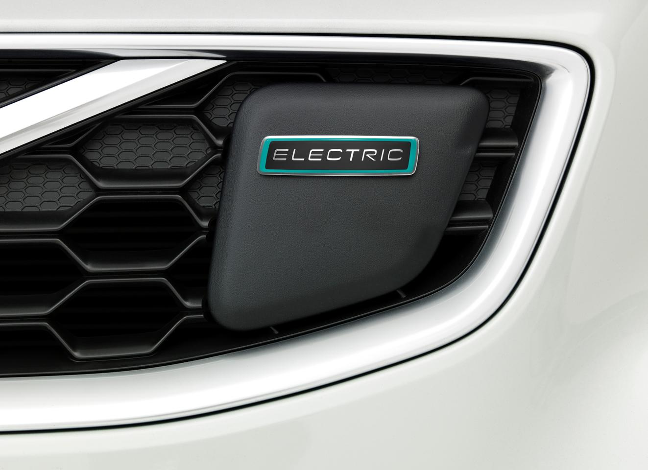 A plug on the grille provides the charging interface