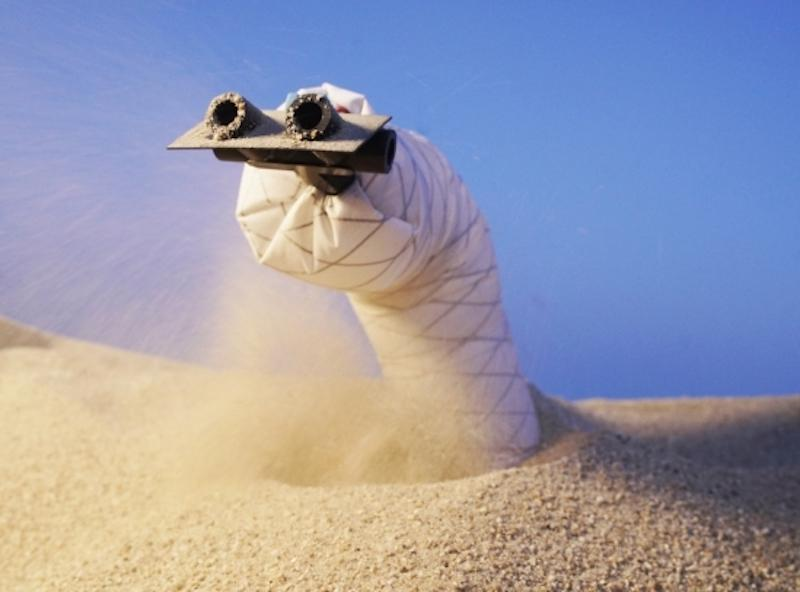 The new sand-burrowing robot has air jets in its front to blast sand out of its path, and a wedge-shaped head to help it steer