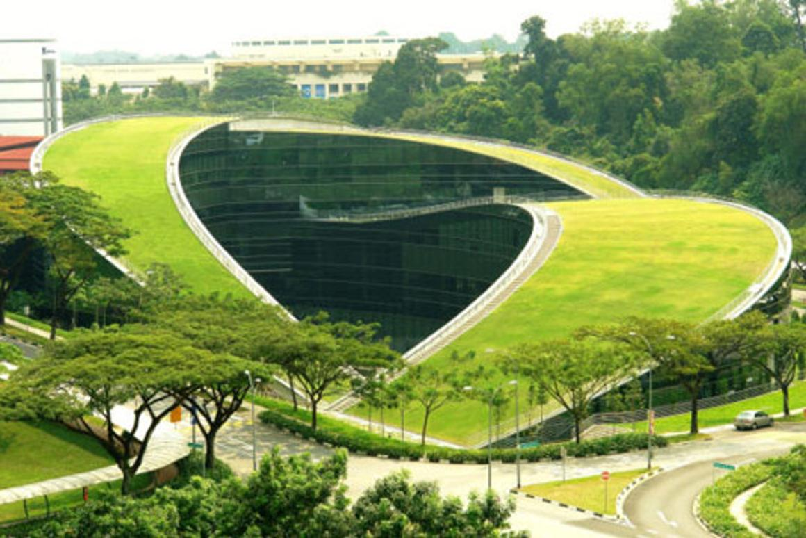 The School of Art, Design & Media at Nanyang Technological University campus in Singapore featuring a turfed rooftop.
