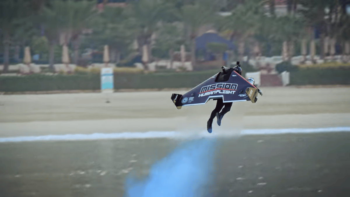 Jetman pilot Vince Reffet takes off from the ground before soaring off into the distance in a world-first transition from VTOL to winged flight