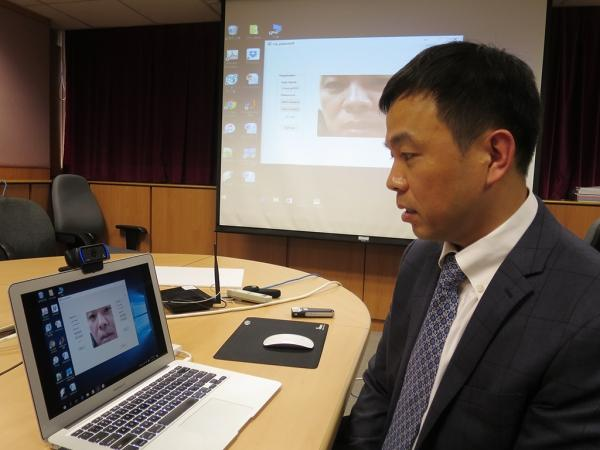 Professor Cheung Yiu-ming demonstrates his team's novel new lip reading password authentication system