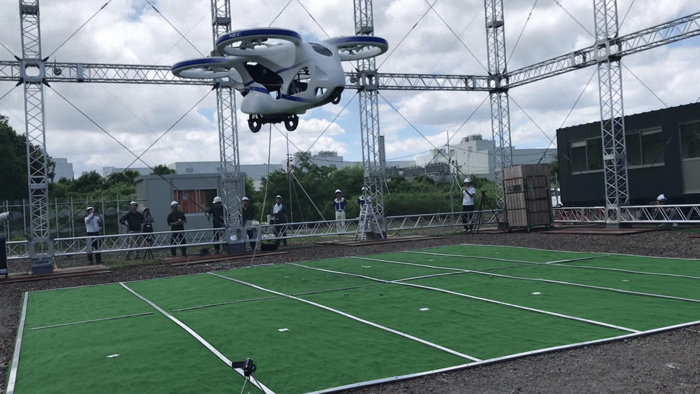 NEC's flying car prototype in caged testing