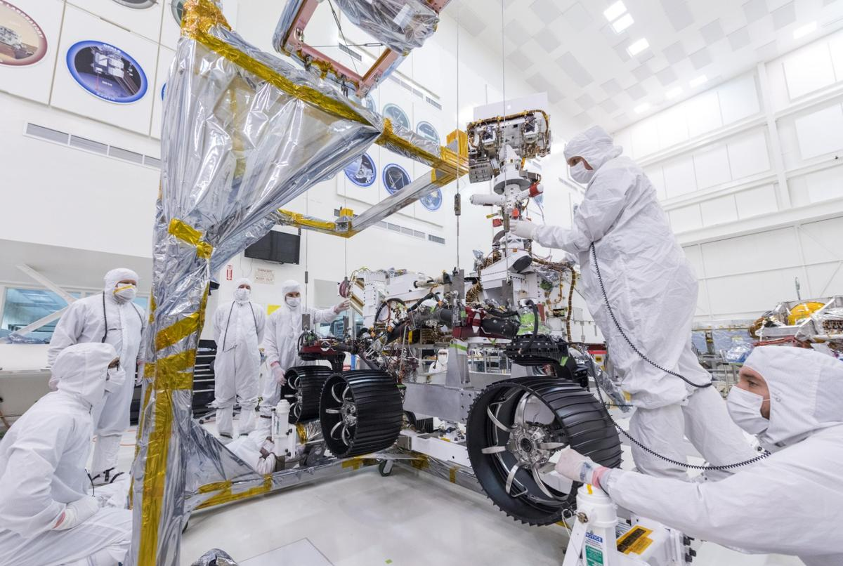 Engineers prepare the starboard legs and wheelsfor integration onto NASA's Mars 2020 rover