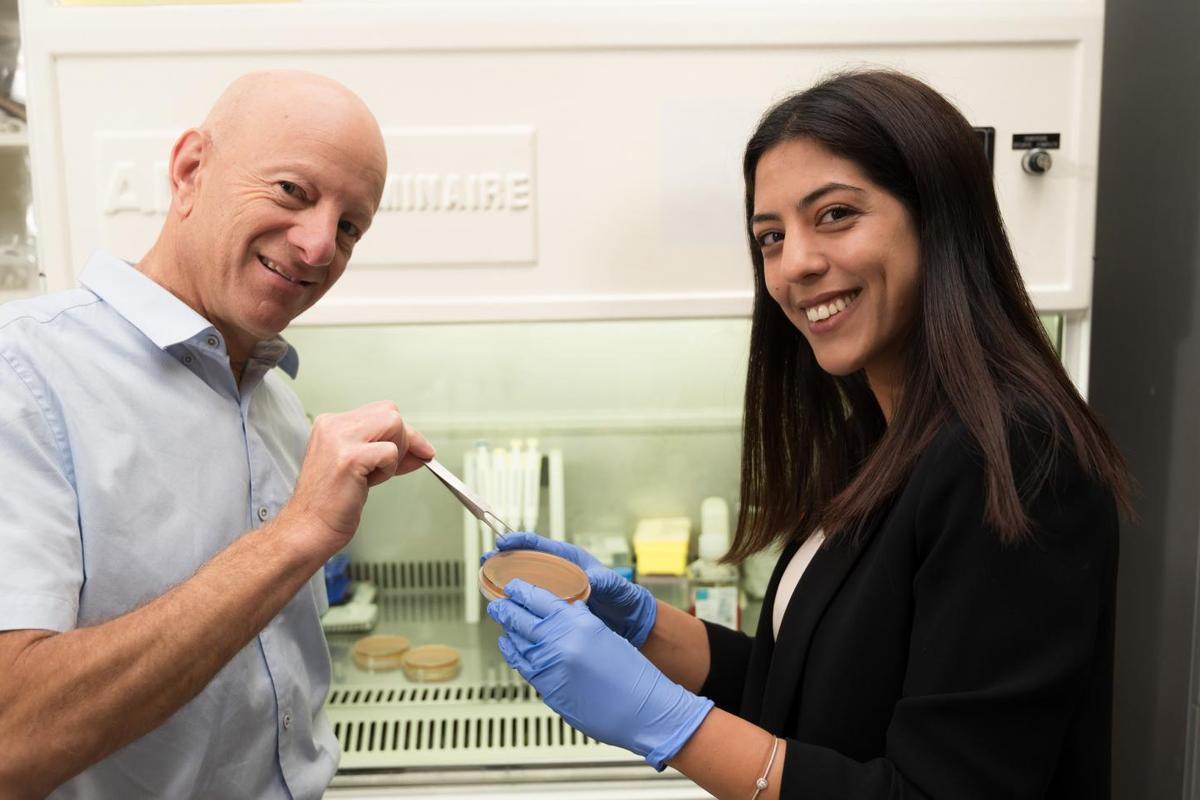 """Researchers Raz Jelinek (left) and his student Ravit Malishev have developed """"molecular tweezers"""" (not pictured) to take apart the defenses of drug-resistant bacteria"""