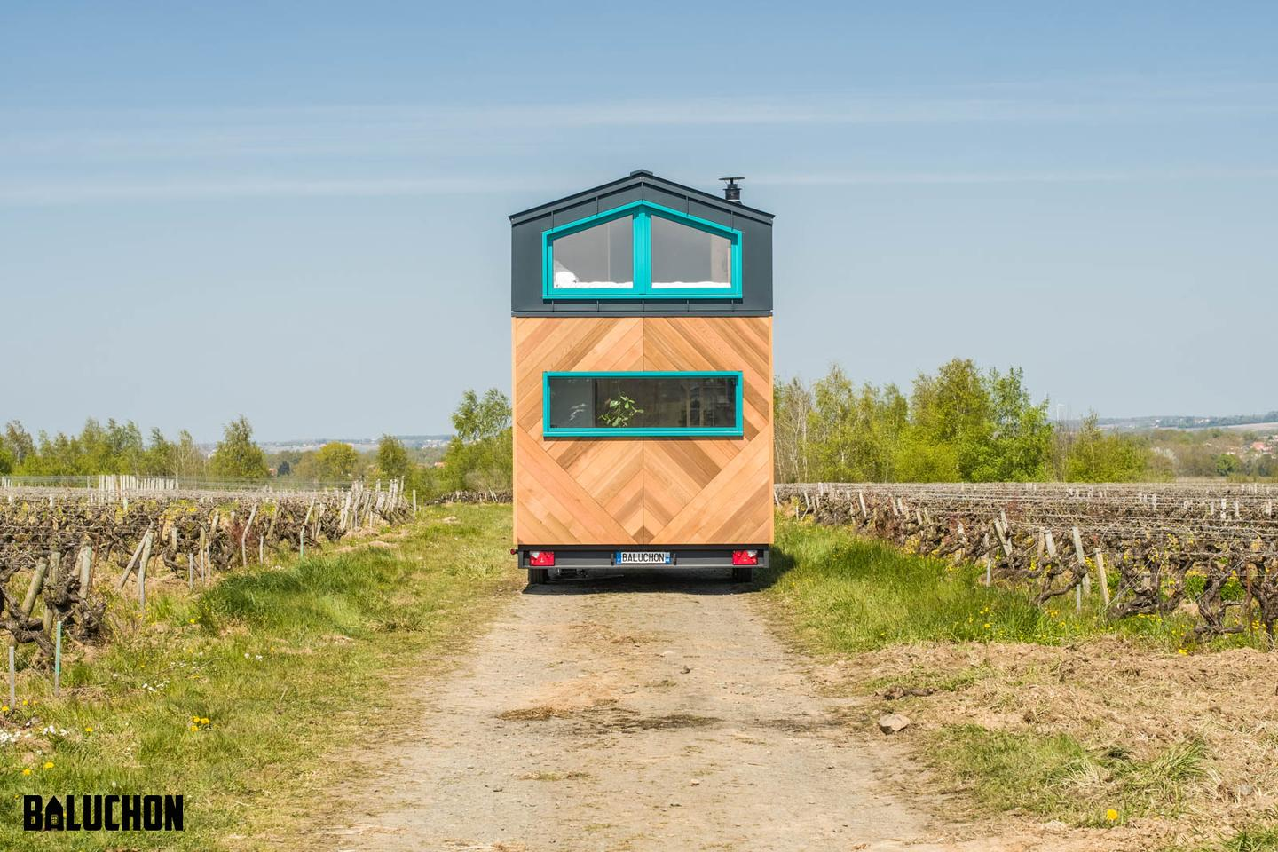 Tiny House Sïana is finished in cedar, with aluminum accenting