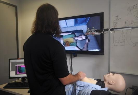 Medical students conduct simulated breast exams on a 'mixed reality' patient