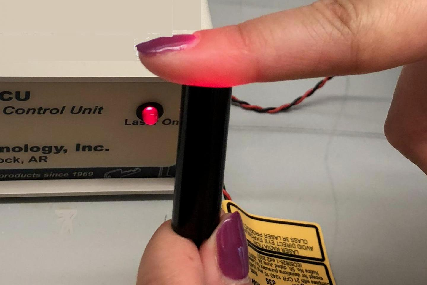 A demonstration of the low-power laser utilized in the study