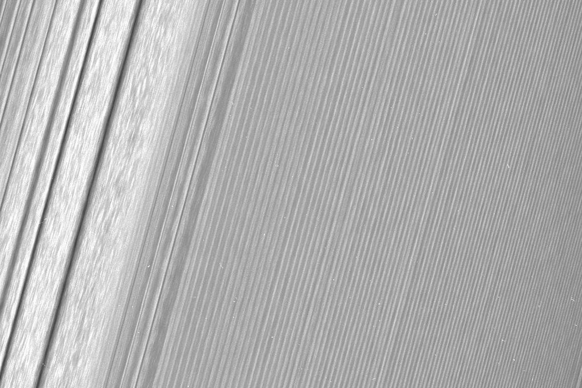 Cassini image of Saturn's A ring featuring a density wave (to the left) and the more subtle wakes created by a ring moon (to the right)
