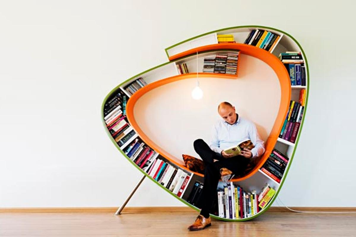 The Bookworm is a chair that surrounds the reader with their library, literally