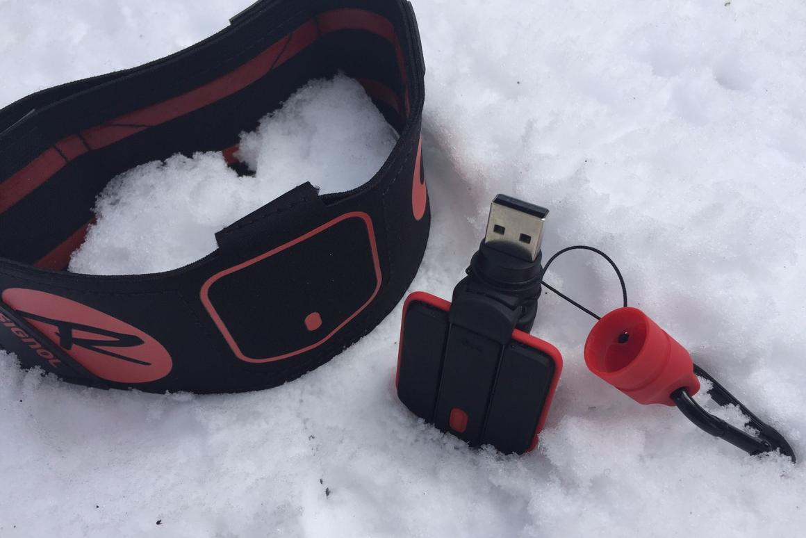 The Rossignol Piq ski sensor is made up of three components: the Piq sensor, a portable charging unit and an ankle strap
