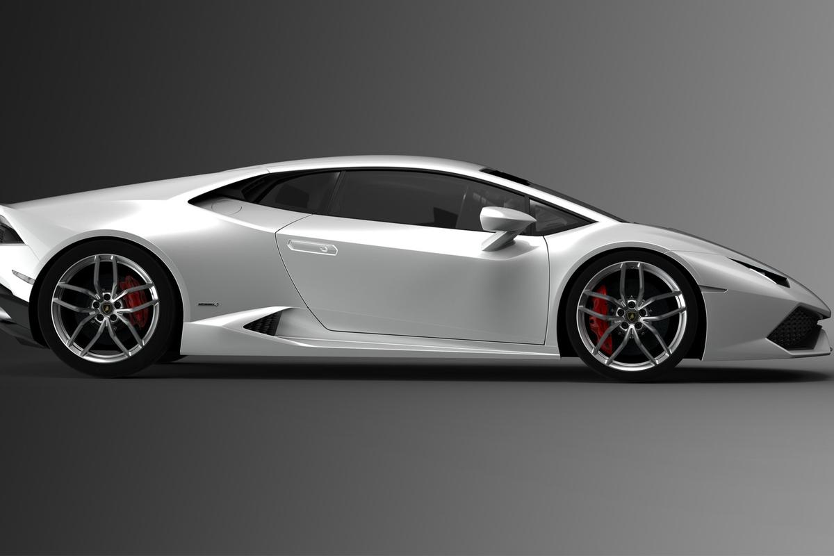 The Huracán retains some Gallardo design elements but is cleaner and less cluttered with one fluid continuous line flowing from the grille to the beautifully sculpted rear end