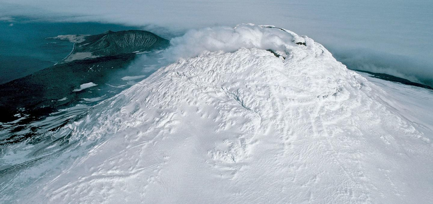 Aerial photograph of Mount Michael and its volcanic plume