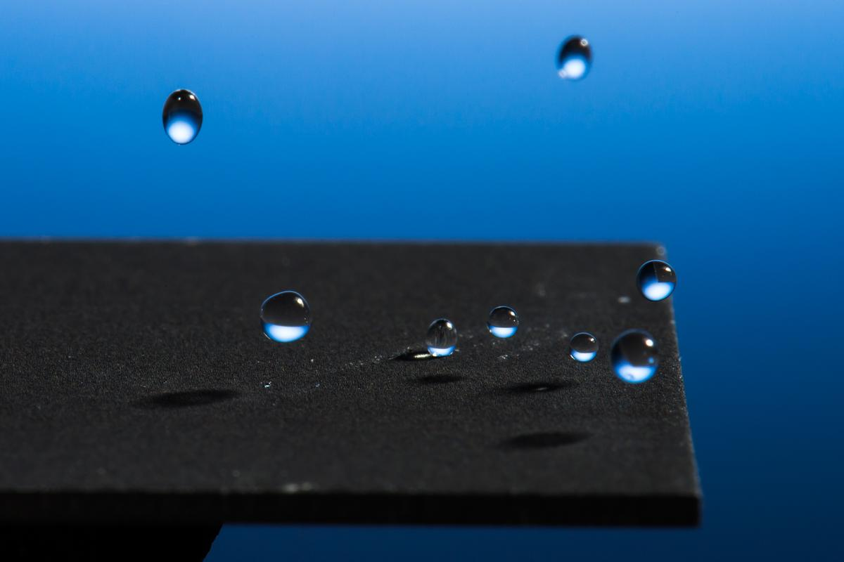 A new laser-based technique renders metal super-hydrophobic without the need for a chemical coating (Photo: J Adam Fenster/University of Rochester)