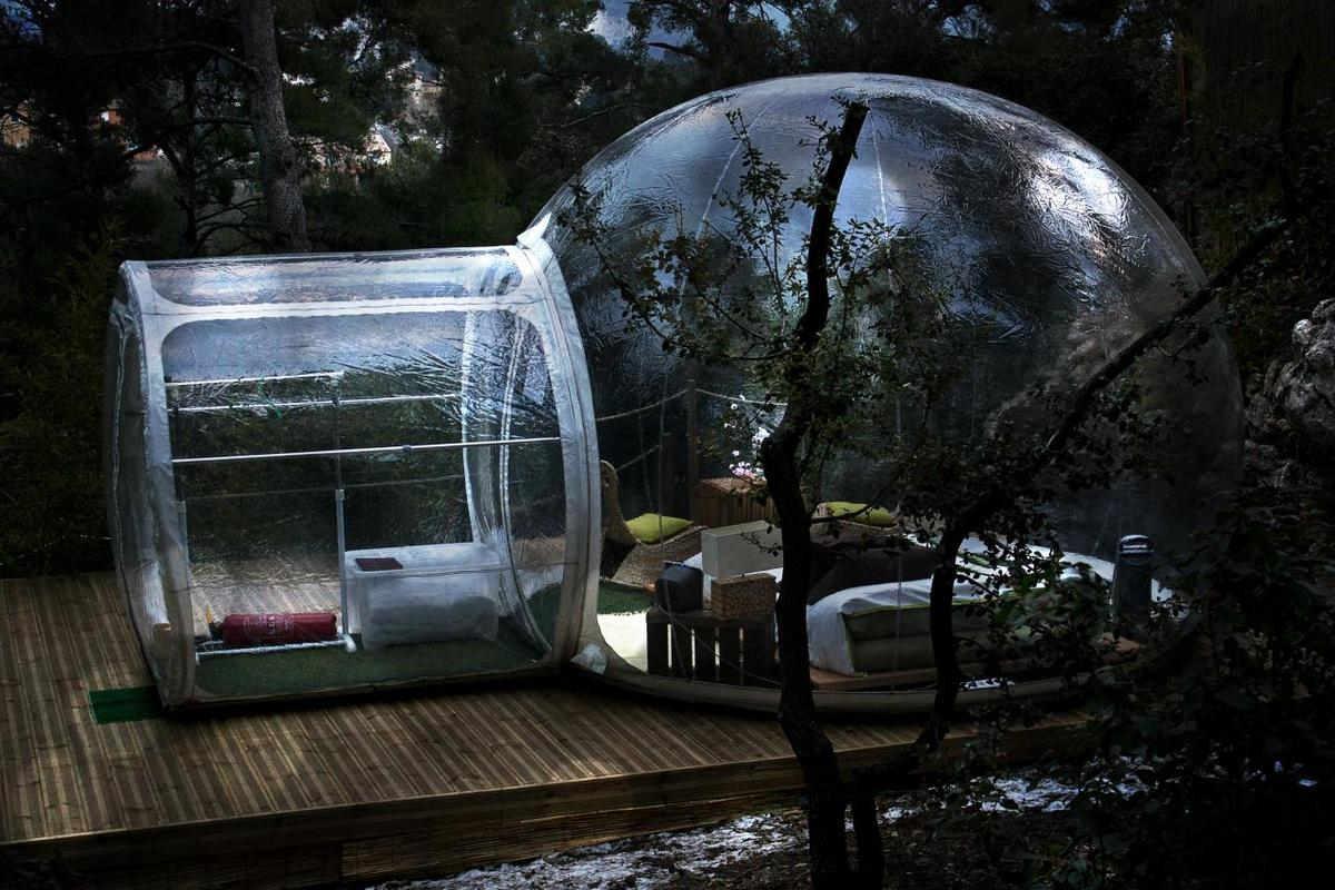 A hotel in France is offering guests the chance to stay in fully-furnished, clear-plastic bubbles and sleep amongst nature