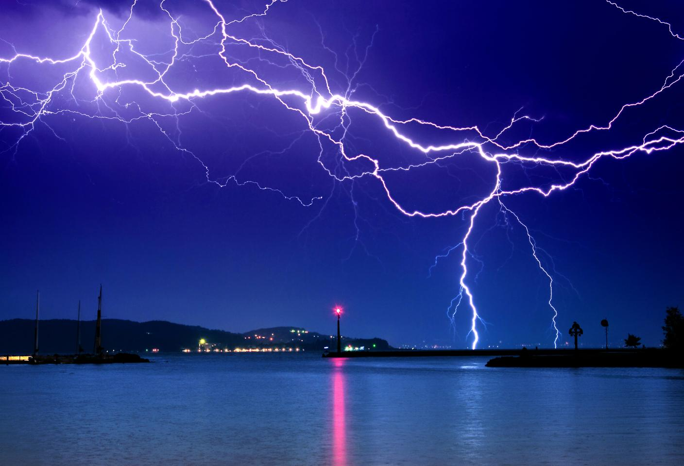 A new study has demonstrated how a tractor beam containing trapped graphene microparticles could one day redirect lightning strikes