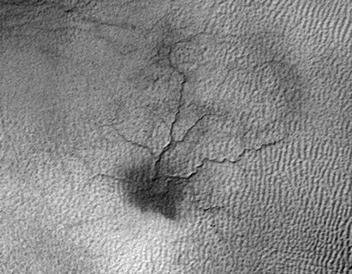 A spider-like surface feature on Mars that scientists believe is caused by thawing carbon dioxide ice