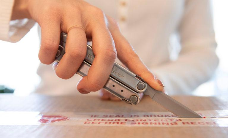The Leatherman Bond in action as a box cutter