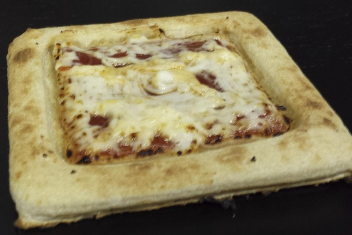 A 3D-printed pizza that astronauts might one day be able to dig into (Photo: Anjan Contractor)