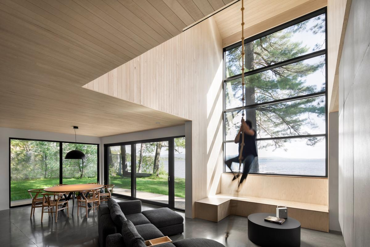 The Lakeside Cabin's living area features a climbing rope hanging from the ceiling